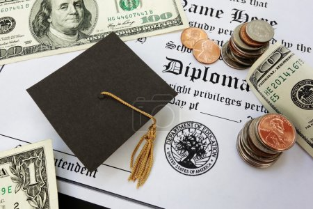 Photo for College or high school diploma with mini mortar board and money - Royalty Free Image