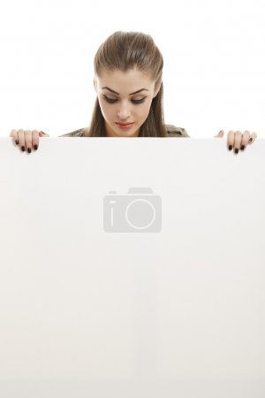 Business woman holding white billboard
