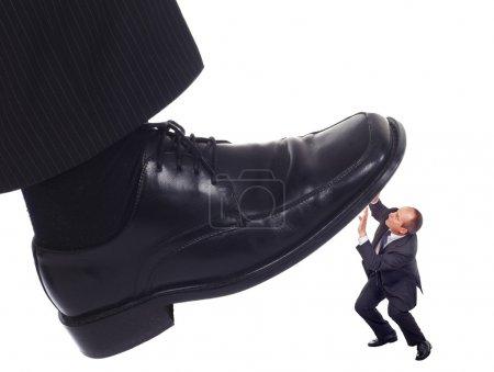 Shoe crushing a businessman