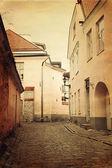 Vintage style photo of old European town street