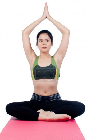 Photo for Beautiful young asian woman in yoga pose - Royalty Free Image