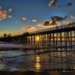 The old wooden Pier in Oceanside, California. A dr...
