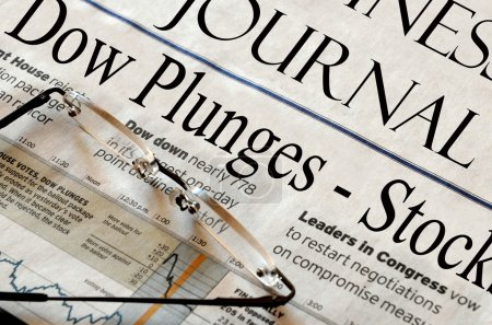 Photo for Dow Plunges - Business and stock market headlines in a newspaper. - Royalty Free Image