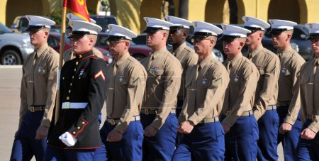 Photo for US Marine trainees at a graduation ceremony. - Royalty Free Image
