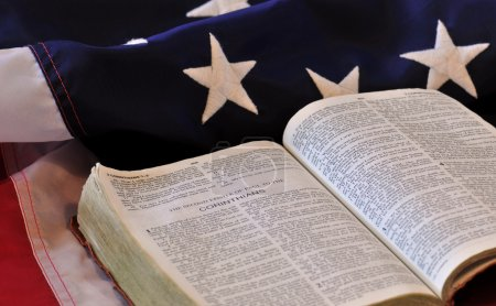 Photo for Christian Nation - bible and flag in a portrayal of national religion - Royalty Free Image