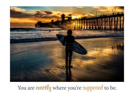 Silhouetted surfer at Oceanside Pier, Oceanside, California.