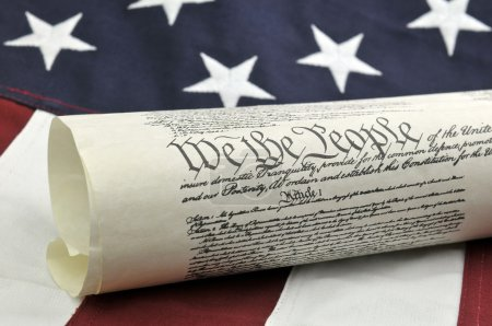 Photo for We The People - US Constitution with an American Flag background. - Royalty Free Image