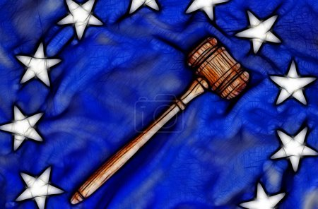 Wooden gavel atop flag