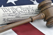 Constitution document, gavel, and American flag