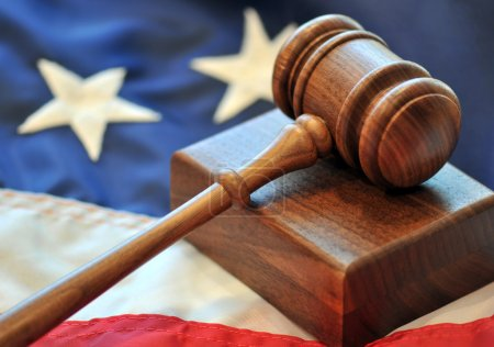 Wooden gavel and American flag