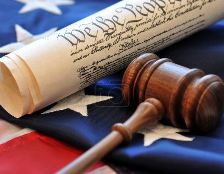 Photo pour We The People - US Constitution and gavel over an American flag background - image libre de droit