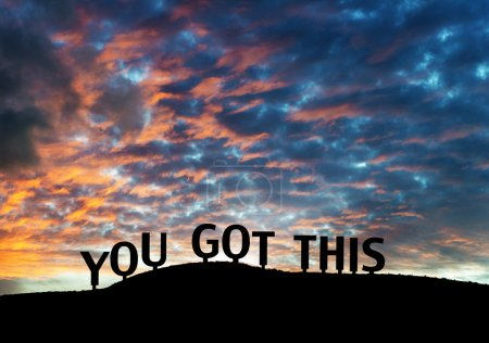 "Photo for Inspirational silhouetted words ""You got this"" on a hillside with colorful sunset clouds. - Royalty Free Image"