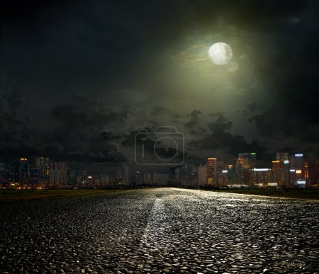 Photo for Asphalt road leading into the city at night - Royalty Free Image