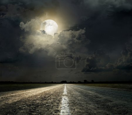 Photo for Dramatic sky over an asphalt road - Royalty Free Image