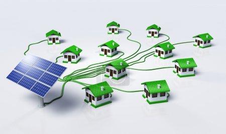Foto de Algunos paneles solares están suministrando pequeñas casas conectándolas con cables verdes, sobre un fondo blanco - Imagen libre de derechos