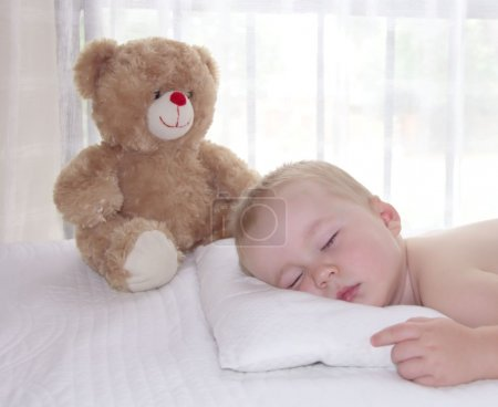 Toddler boy is sleeping on the pillow