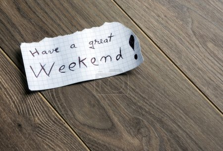 Photo for Have a great Weekend - Hand writing text on a piece of paper on wood background with space for text - Royalty Free Image