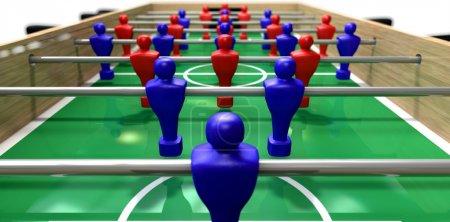 Photo pour Une vue en perspective d'une table de baby-foot en bois montrant une équipe bleue et rouge sur un terrain vert marqué sur un fond blanc isolé - image libre de droit