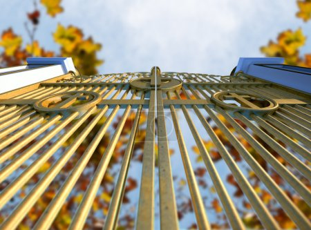 Photo for A concept image of the golden gates to heaven shut on an autumn leave and blue sky background - Royalty Free Image
