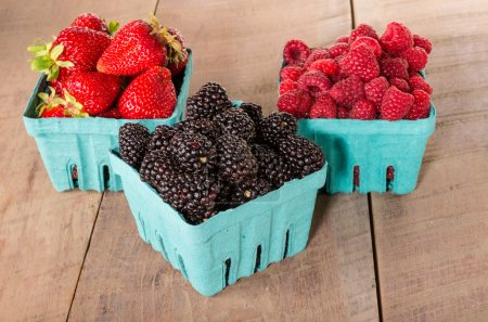 Photo for Boxes of fresh sweet berries blackberries strawberries raspberries - Royalty Free Image