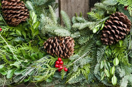 Photo for Holiday wreath of evergreen branches and cones - Royalty Free Image