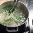 Green beans in boiling water in a cook pot...
