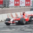 Постер, плакат: Charles Pic of Marussia F1 Racing at Moscow City Racing 2012