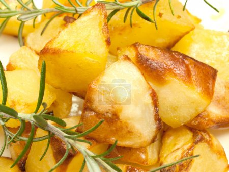 Photo for Baked sweet potatoes with rosemary - Royalty Free Image