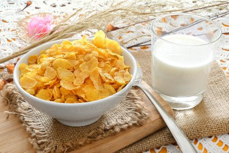 Photo for Breakfast table with cornflakes cereal and milk - Royalty Free Image