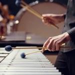 Sticks hitting a xylophone closeup...