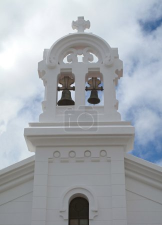 White bell tower of a church