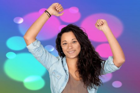 Photo for Winner attractive woman in the disco dancing with a purple background - Royalty Free Image