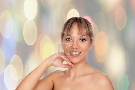 Photo for Portrait of beautiful female model with a sparkle background - Royalty Free Image