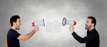 Two Young Men Shouting Through Megaphone