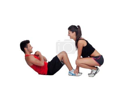 Photo pour Gym hommes exerçant avec son entraîneur personnel isolé sur un fond blanc - image libre de droit