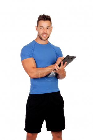 Photo for Handsome personal trainer with a clipboard isolated on a white background - Royalty Free Image