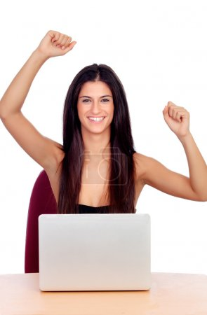 Winner brunette girl with a laptop
