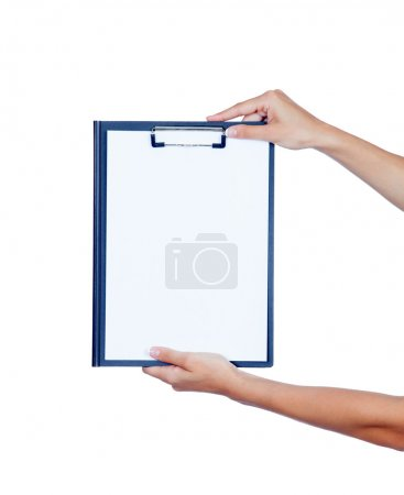 Clipboard with blank paper held by a woman hands