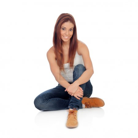 Casual young woman sitting on the floor