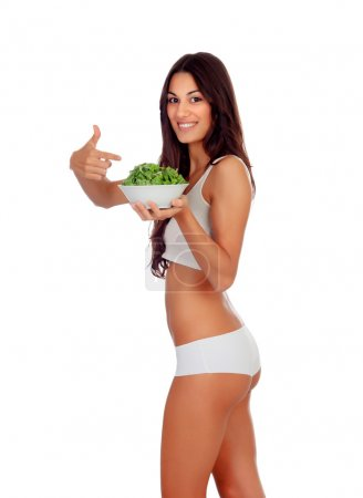 Girl in white underwear pointing a salad