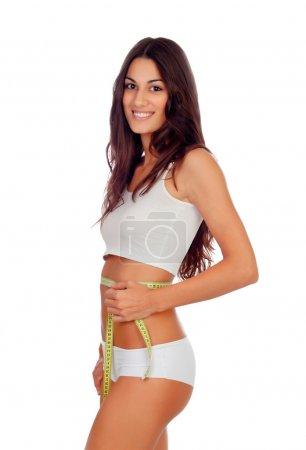 Girl in white underwear with a tape measure around her waist