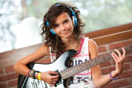 Cute girl at guitar practice.