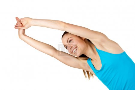 Young fit woman stretching arms.