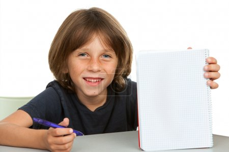 Cute kid showing notebook with blank copy space.