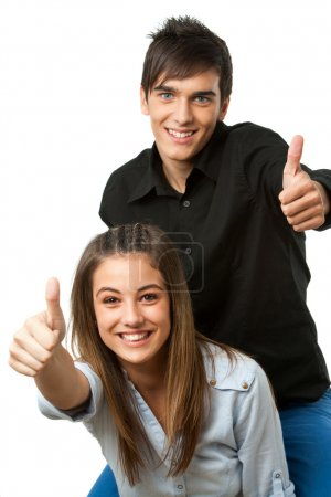 Cute teen couple showing thumbs up.