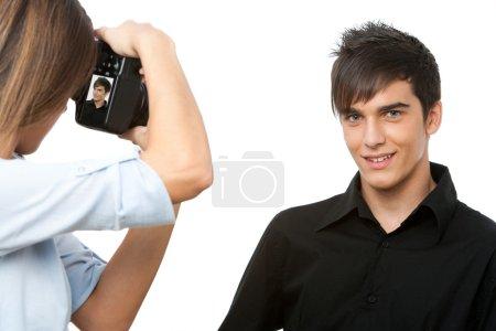 Young male model posing at camera.