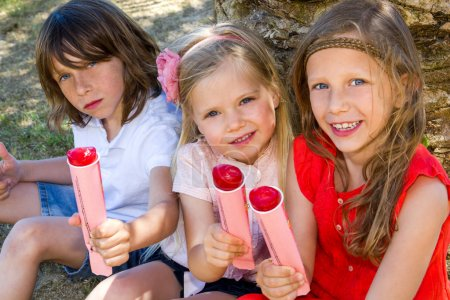 Children enjoying ice pops.