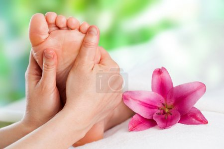 Photo for Close up of hands massaging female foot. - Royalty Free Image
