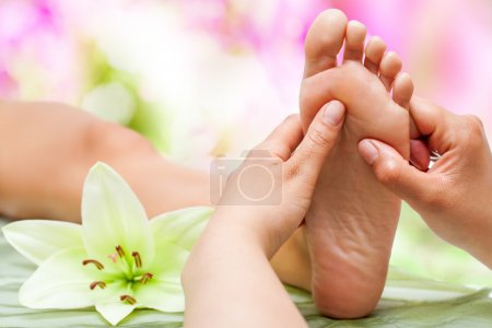 Photo for Close up of therapist's hands massaging female foot. - Royalty Free Image