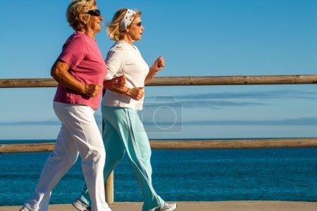 golden girls jogging along beachfront.